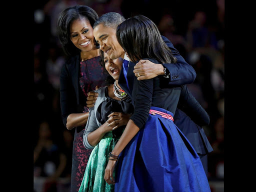 U.S. President Barack Obama (R) celebrates with first lady Michelle Obama and their daughters Malia (R) and Sasha at their election night victory rally in Chicago.