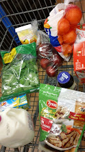 Photo: Since my mother-in-law needed us to pick our daughter up early, my husband had been scurrying around grabbing other items. By the item I had picked out  Tyson chicken and pizza sauce, he had already loaded our cart!
