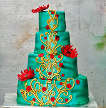 Photo: Turquoise and Gold Engrave with Red Sugar Flowers, a elegant wedding cake. www.caramelbakery.in
