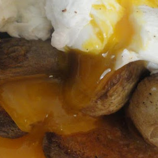 Poached Eggs On A Bed Of Fried Mushrooms and Country White Bread