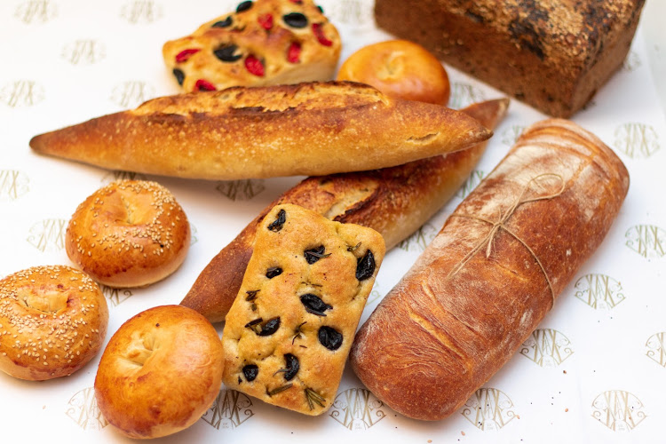 A selection of L'atelier Bakery's breads, which are available in store and for wholesale purchase.