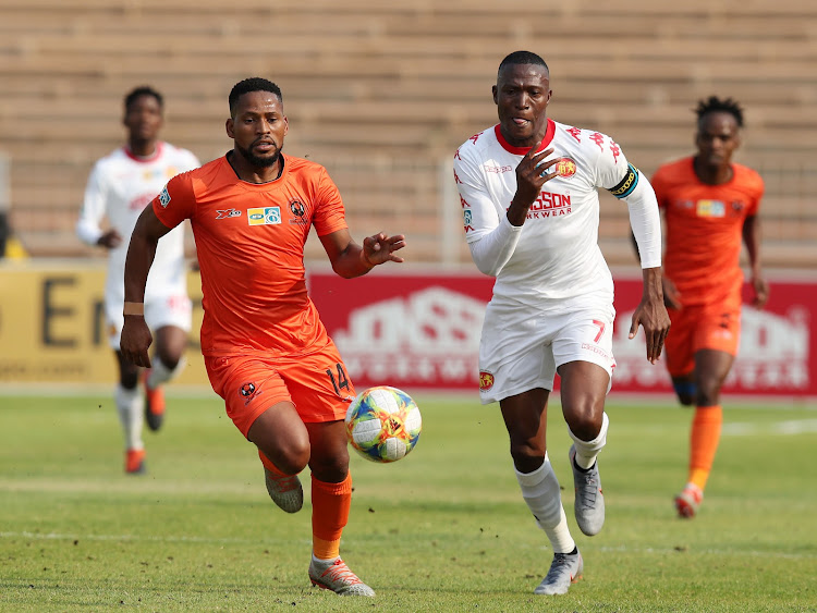 Edgar Manaka (L) and Tandai Ndoro vie for the ball as both teams fired blanks.
