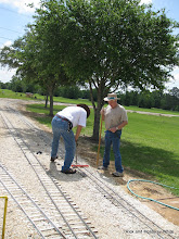 Photo: Doug Blodgett and Phillip Bell working on the 4.75 inch gauge track.  HALS SWLS 2009