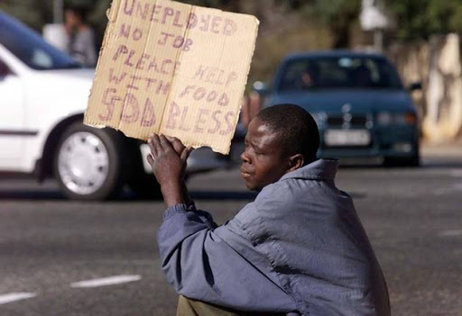 An unemployed young South African pleads for money or food at a Johannesburg street corner.