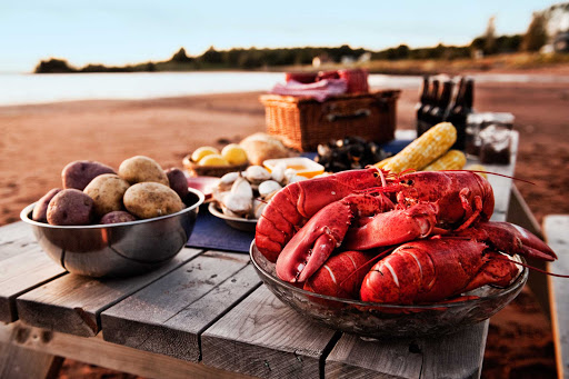 A spread of lobster and seafood at a beach clambake in Charlottetown, Prince Edward Island, Canada.