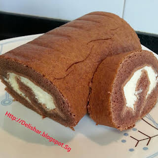 Moist Milo Cake Roll with Condensed Milk Sweetened Whipped Cream.