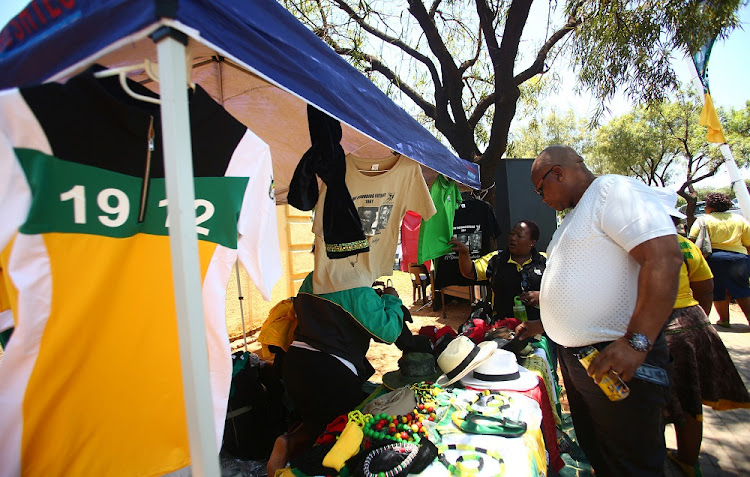 Hawkers ply their trade on the sidelines of the 54th ANC National Elective Conference held at Nasrec on 18 December 2017.