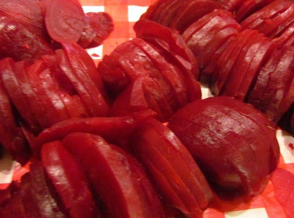 Pour beets in sink, rinse off and let cool take the stems and the root...