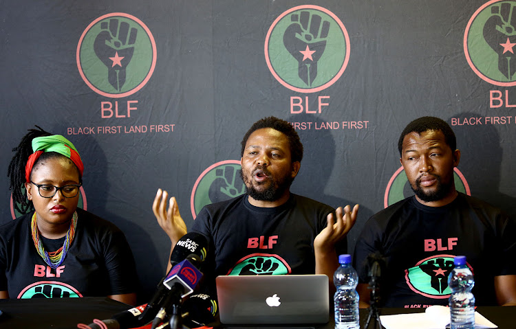 Black First Land First president Andile Mngxitama (centre), deputy president Zanele Lwana (left) and general secretary Siphesihle Jele at a press conference on December 11 2018.