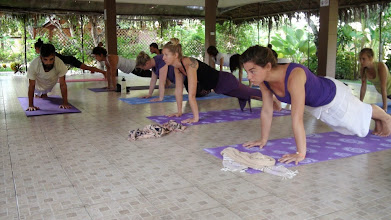 Photo: Daniel teaching plank pose to the students