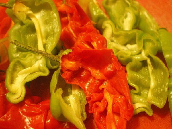 Cut peppers in half and remove ALL seeds, and trim off as much of...