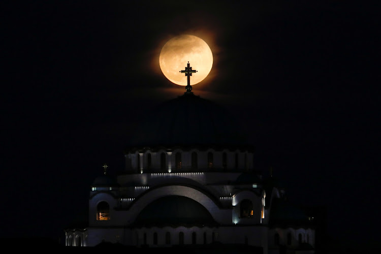 A full moon rises behind St. Sava temple in Belgrade, Serbia, January 31, 2018.