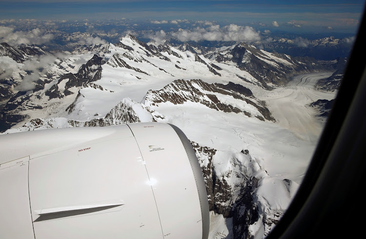 Lufthansa unit Swiss International Air Lines new Bombardier CS100 aircraft flies past the Jungfraujoch and the Aletsch Glacier (R) during a flight over the Swiss Alps, Switzerland July 6, 2016.