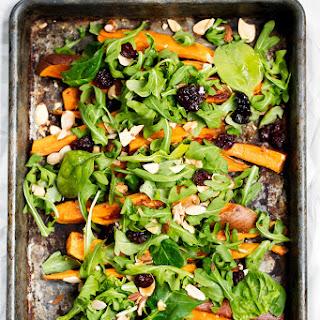Garlic Roasted Sweet Potato & Arugula Salad with Turmeric Honey Mustard Yogurt Dressing Recipe
