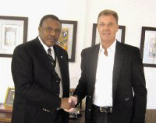 HIGH HOPES: Orlando Pirates boss Irvin Khoza with new Bucs coach Rudolf Josef Krol at the club's office yesterday. Photo: Ramatsiyi Moholoa. 12/06/08. © Sowetan.
