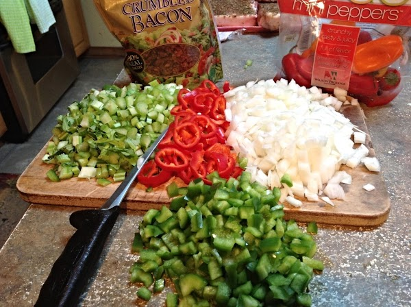 Chop the celery, onions green peppers & mini red peppers.