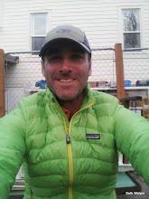 Photo: Happy in my new (very visible) puffy jacket. Secretly camping behing the Grange