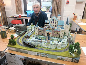 Photo: 023 Moving across the room we find Wessex NGM member Alan Hamer with The Castle Line, a superb model of the Chitty Chitty Bang Bang castle that was made by Sue Hamer using Linka moulds, and now has a narrow gauge railway in order to transport the tourist visitors. Alan used this layout to demonstrate the properties of a variety of different types of controllers .
