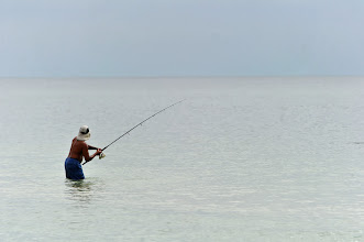 Photo: A man fishes at Gulf Shores beach on Tuesday, October 11,2011.