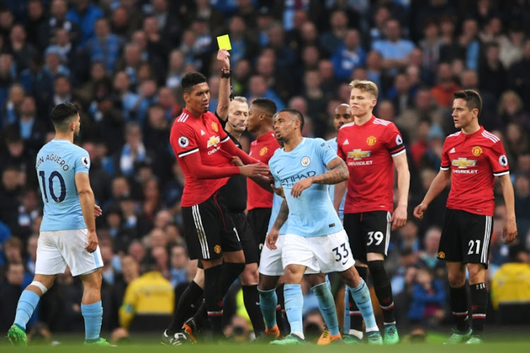 Gabriel Jesus of Manchester City is shown a yellow card by referee during the Premier League match between Manchester City and Manchester United at Etihad Stadium on April 7, 2018 in Manchester, England.