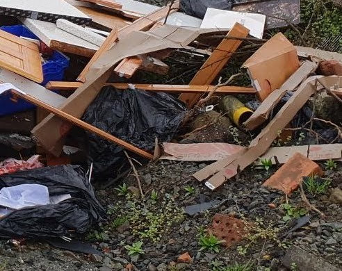 Newtown builder fined for fly-tipping