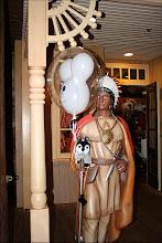 Photo: Carlisle holds his Mickey ear balloon while posing witha cigar Indian in Magic Kingdom, Walt Disney World.