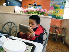 Photo: warrenzh 朱楚甲 during KFC breakfast and playing video game on his fonepad, after reunited benzrad, his proud dad, in Friday night in the dad's dorm and breakfast in nearby KFC in next morning. thx God, the coming spring festival descending with peace and richness.