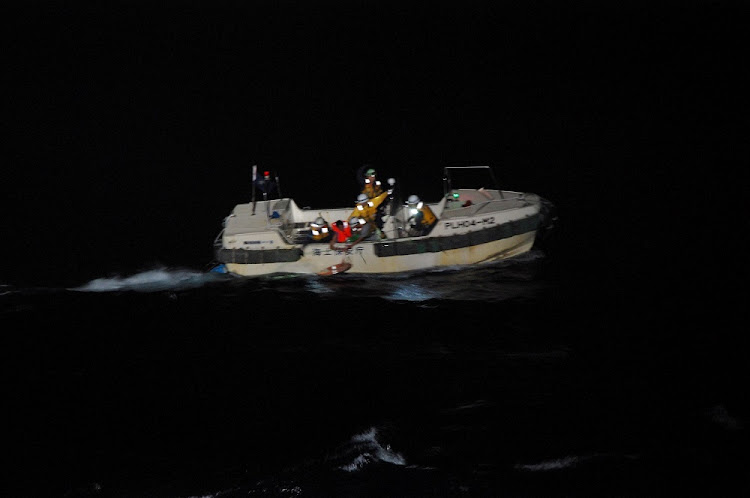 A Filipino crew member believed to be onboard Gulf Livestock 1 is rescued by a Japan Coast Guard boat. Picture: JAPAN COAST GUARD/HANDOUT VIA REUTERS