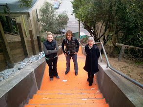 Photo: Hidden Garden Steps (16th Avenue, between Kirkham and Lawton streets in San Francisco's Inner Sunset District) organizing committee members and other volunteers (left to right: Cori Holland, Ceal Bialobrzeski, and Barbara Meli), on Saturday, November 2, 2013, had their first onsite visit as installation of the 148-step ceramic-tile mosaic designed and created by project artists Aileen Barr and Colette Crutcher continued. For more information about this volunteer-driven community-based project supported by the San Francisco Parks Alliance, the San Francisco Department of Public Works Street Parks Program, and hundreds of individual donors, please visit our website at http://hiddengardensteps.org.