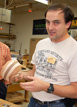 Photo: Ilya Zavorin shows a laminated bowl form he is working on.