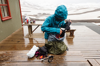 Photo: Serene hurriedly packing up after the weather broke during our coffee break at the hut
