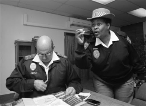 20100708VNH.  ALL SYSTEMS GO: JMPD  Director of operations Gerrrie Gerneke and JMPD Spokesperson Edna Mamonyane during a press briefing at the offices in Faraday.Pic:VELI NHLAPO. 08/08/2010. © SOWETAN