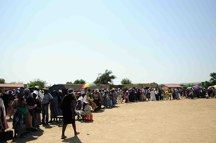 Pensioners wait in a queue at a Sassa pay point in Mpumalanga. Picture: SOWETAN