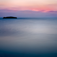 """Photo: last piece of land before the sun  Seconds after the sun set at Vouliagmeni, last week. That was quite strange. The wrinkles shaped by the wind on the surface of the sea were absolutely frozen in some places. Despite my stacking 2 ND filters, an ND8 on the top of a ND400 and getting an exposure of 110"""" one can still notice some structure in the sea's surface. Not that it bothers me, on the contrary, but I was expecting the sea to go flat at that exposure. Anyway ...still discovering, and THAT's the beauty of it!!  as the hour here is weeeeeeeell past bedtime, I'm gonna cheat a bit and post it for both #SunsetSaturday curated by +TJ Kelly and #SkySunday of +Simone Linke"""