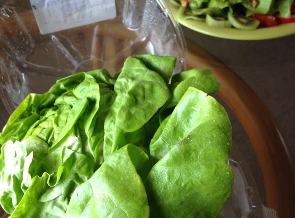 Wash baby lettuce leaves ,shake to dry. Slice  Kiwi & Strawberry placing around...