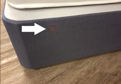 locate pre-drilled holes in divan base