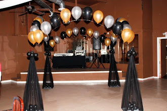 Photo: draped columns and string of pearls around
