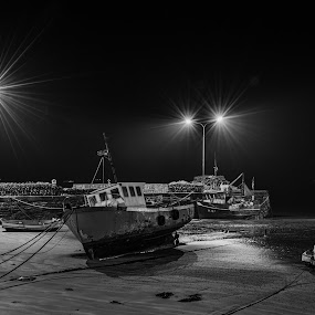 The day's fishing is over by John Holmes - Black & White Landscapes ( sand, monochrome, beached, cork, ireland, black and white, harbour, boats, lights, winter, youghal, quays, night, long exposure, fishing, street lights,  )