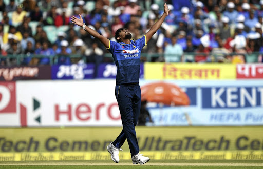 Sri Lankan cricketer Suranga Lakmal celebrates the wicket of Indian cricketer Dinesh Karthik during yesterday's first ODI  in Dharamshala, won impressively by the Sri Lankans after Lakmal's superb bowling.