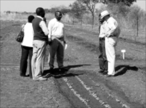 SMALL BEGINNINGS: Ian Daniels, far right, and officials from Limpopo's government departments inspect some of the essential oil-bearing plants at La Boheme farm near Trichardtsdal. Pic. Michael Sakuneka. 08/07/08. © Sowetan.