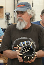 Photo: Ed Karch, MCW's resident Arteest, shows his latest interesting, spiky creation.  Gotta love it.