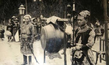 Photo: Võ quan mang kiếm, giáo đứng cạnh trống lễ hội