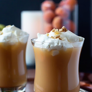 Pear Nectar And Brandy Warmer With Whipped Cream And Chopped Walnuts.