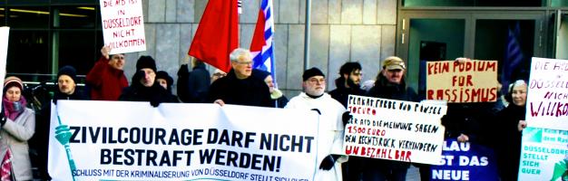 Demonstrant:innen, Fahnen, Plakate «Zivilcourage darf nicht bestraft werden!».