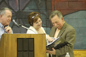 Photo: Jane Chilutti, volunteer for Katie Kirlin Fund, presents Stu Greenberg with a photo album of 15 years of the tournament.