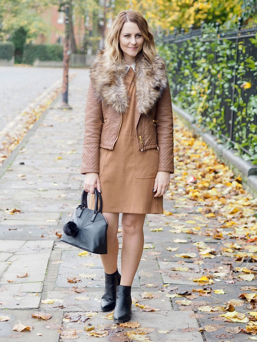 Blogger in tan biker jacket and suede pinafore
