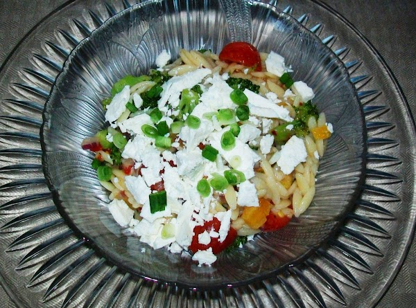 Top with the feta cheese and garnish with the green onions just before serving.