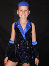 Photo: Custom Made!   To buy, reference (CSD-Dark Blue Jacket w/hat ) & email me at Pam@Act2DanceCostumes.com   $85.00  Qty (1)  Size: (1) Child Med.   Glittering dark blue jacket with rhinestoned lapel and buttons. The back of the jacket is sheer so it appears to be a halter jacket. There is a ton of movement with this jacket and would be great for tap or jazz. Includes hat and gloves. Wear it with a pair of black booty shorts. Rhinetones on jacket: Grab your back up supply to replace the few that are missing. See photos for condition. Glue strings can only be seen when up close so dont shy away from this fun costume!  7 day returns same condition! Paypal/Credit/Western Union accepted.  US shipping $10 plus 3% paypal fee for costumes over $100  Contact for world wide shipping quote. Thanks!   CSD050