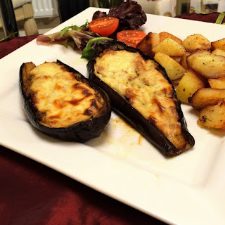 Eggplant boats with Beef and Bechamel Sauce.