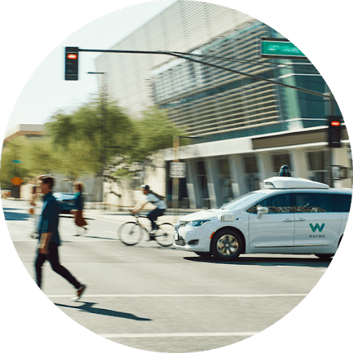 Waymo's autonomously driven Chrysler Pacifica Hybrid minivan at intersection